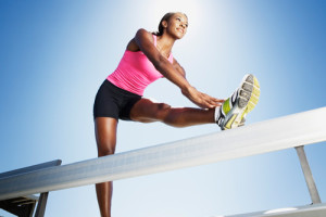 woman-stretching-running-shoes-lgn